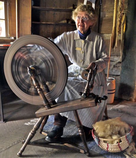 Lady spinning yarn at the Mabry Mill